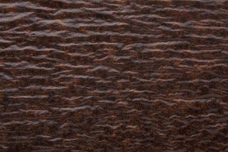 Brown kraft wavy paper background. Cardboard carton