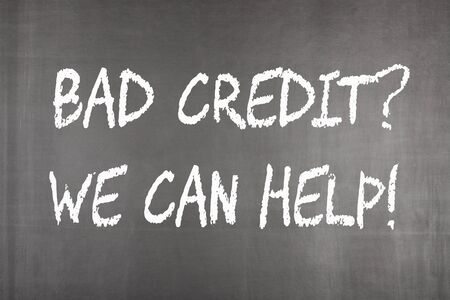 Bad credit and we can help written on blackboard.