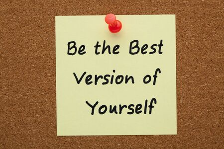 Be the best version of yourself phrase on note pinned on cork board.