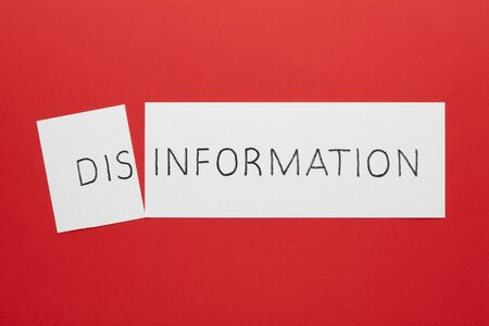Changing the word disinformation to information on a white sheet