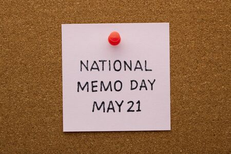 National memo day may 21 text on note pinned on cork board.