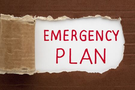 Emergency plan text under torn paper. Business concept Stockfoto