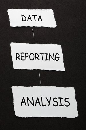 Three step process of data reporting and analysis on piece of torn paper over black surface.