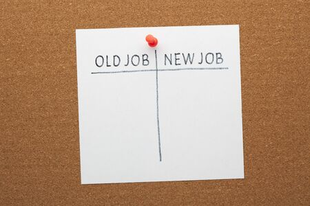 New Job versus Old Job concept on white paper sheet pinned on cork board. Empty list