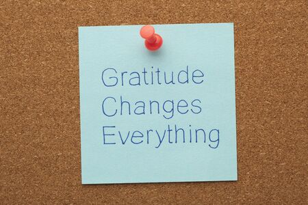 Gratitude Changes Everything text on note pinned on cork board.