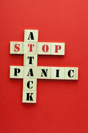 Stop panic attack crossword clue on red background.
