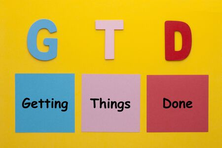 Acronym of GTD for Getting Things Done written on a note.