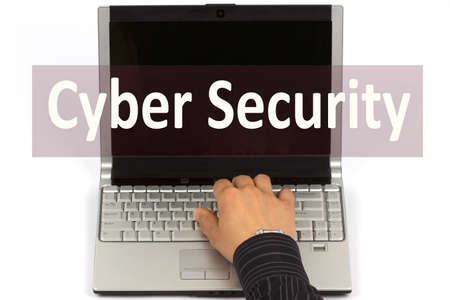 Man hand on laptop keyboard with text Cyber Security