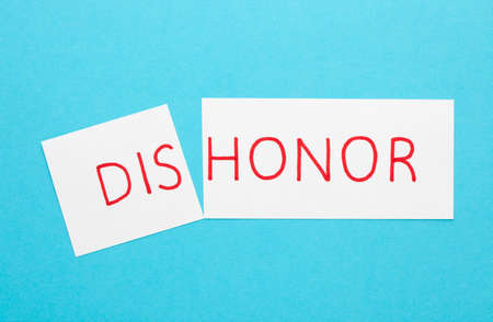 Changing the word dishonor to honor on a white sheet 스톡 콘텐츠