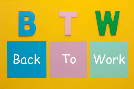 Acronym of BTW - Back To Work written on a note