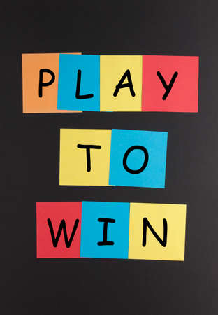 Play to win text on colorful notes. Motivation concept.