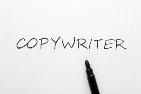 The word copywriter written on white paper sheet and black marker
