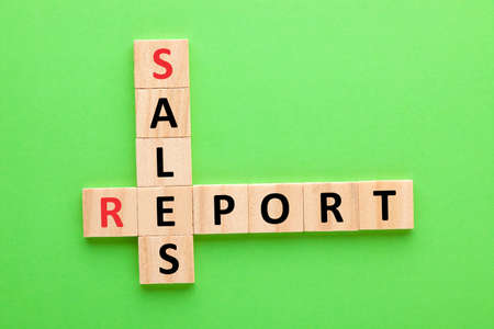 Sales report crossword on green background