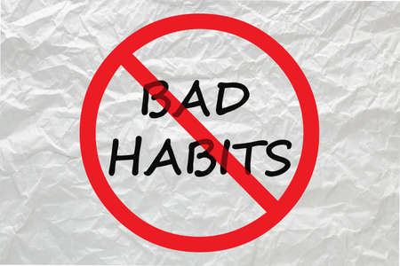 Stop bad habits sign on white crumpled paper.