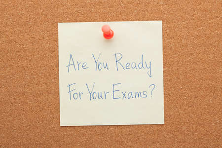 Are You Ready For Your Exams handwritten note pinned on cork board. 免版税图像