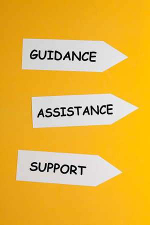 The word guidance, assistance and support in arrows on yellow background. Business concept.