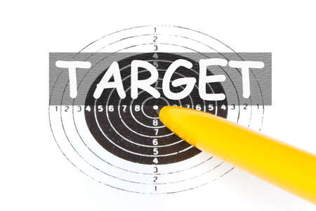 The word target on yellow pen struck directly in center background 免版税图像