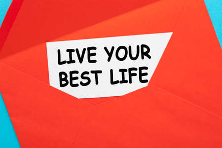 Open envelope with live your best life message. 免版税图像
