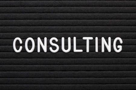 The word consulting on letter board. Business concept