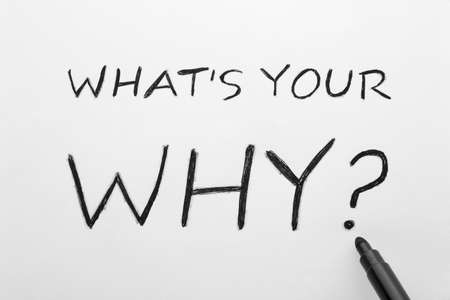 What's Your Why text on white paper sheet and black marker