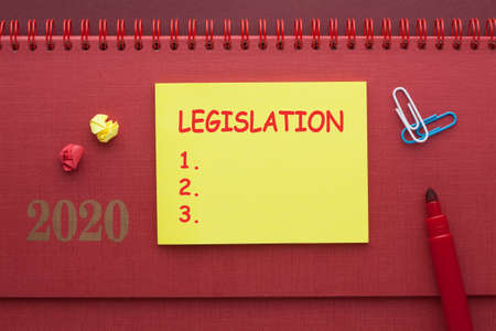 Legislation blank list on note with marker on red background.