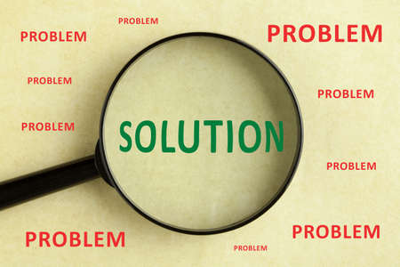 Magnifying glass over the word problem and solution concept background