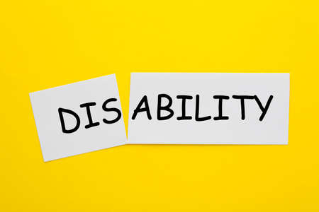 Changing the word disability to ability on a white sheet.