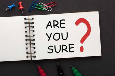 Are you sure question on open spiral notebook and various stationery. Business concept.
