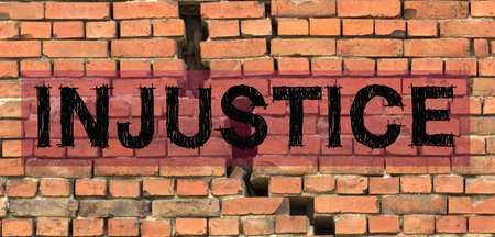The word injustice over large crack in the house.