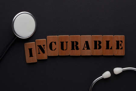 Changing the word incurable to curable on wooden blocks with stethoscope. Medical concept.