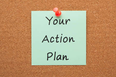 Your Action Plan handwritten note pinned on cork board.
