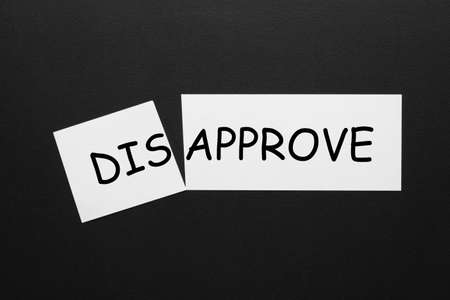 Changing the word disapprove to approve on a white sheet. 免版税图像