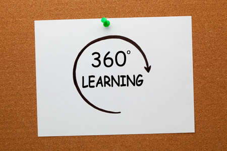 360 degrees learning concept on white paper sheet pinned on cork board.