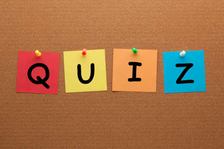 Quiz on colorful notes pinned on cork board