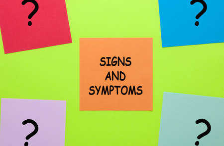 Signs and sisymptoms text with question mark on note