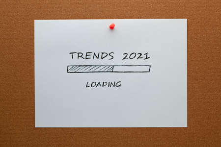 2021 Trends loading bar drawing on white paper sheet pinned on cork board
