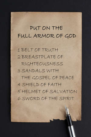 Put on the full armor of God written on old paper with fountain pen. Фото со стока