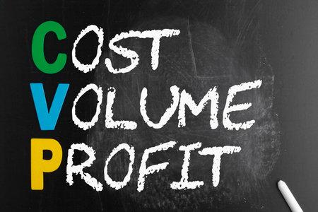 CVP - Cost Volume Profit acronym with chalk on blackboard. Business concept