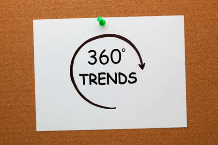 360 degrees Trends concept on white paper sheet pinned on cork board.