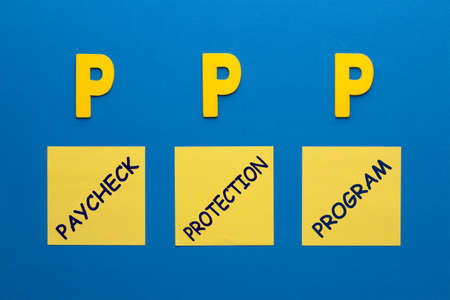 The words Paycheck Protection Program (PPP) on sticky notes sets. Acronym business concept