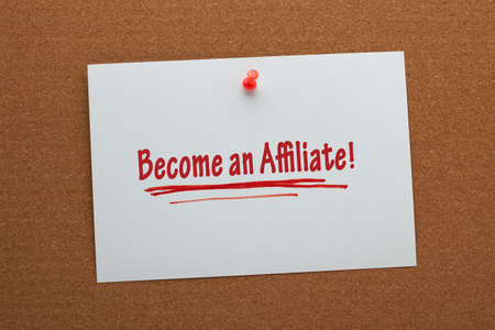 Become an Affiliate written on white paper sheet pinned on cork board. Business concept