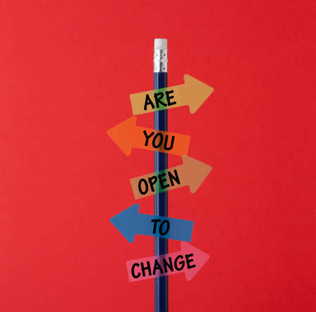 Are you Open to Change written on colored arrows.