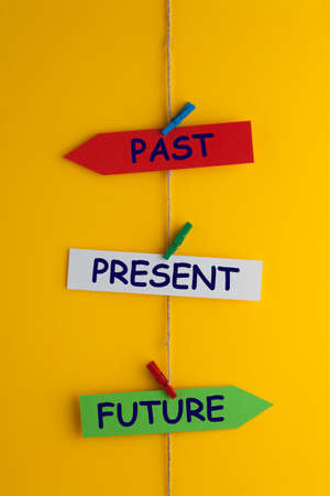 Past, Present and Future written on paper arrow clip hanging. Time concept