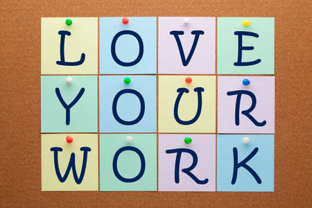 Love your work text on notes pinned on cork board. Motivation concept