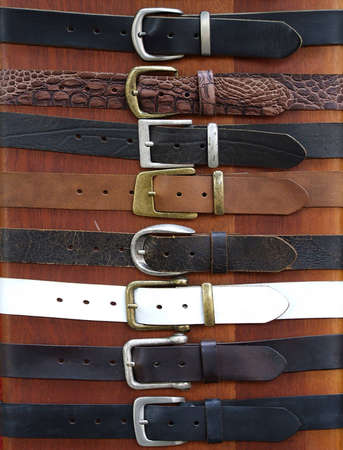 waistband: Leather belts on wood background for different uses