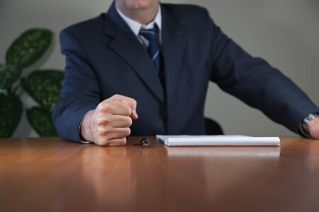 assertion: Fist on the table  Stock Photo