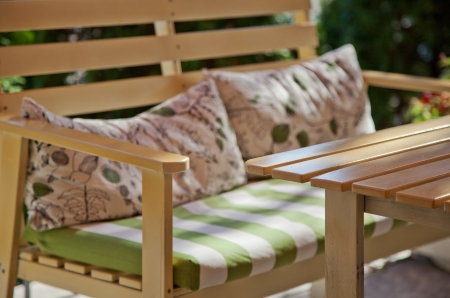 Outdoor furniture in a sunny summer garden  photo