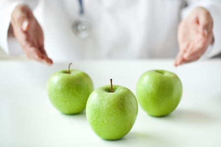 Doctor is advising to eat more fruits  photo