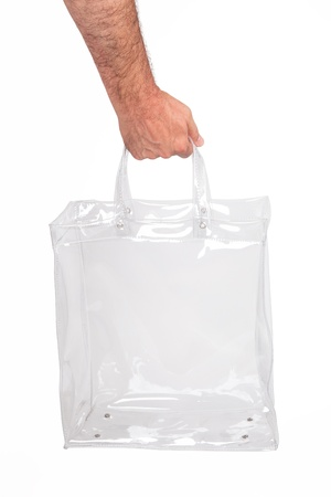 suture: Human hand with transparent plastic bag, isolated on white.