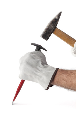 Hammer and chisel in human hands
